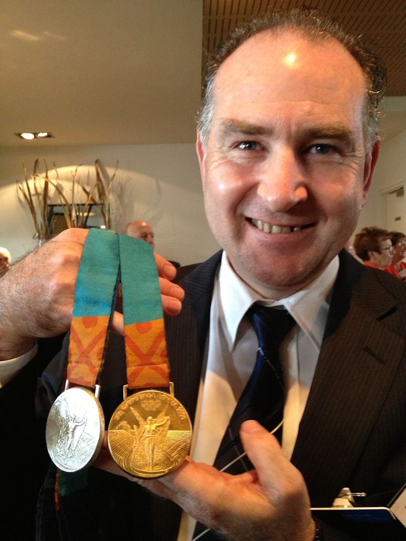Ray Keefe with Brooke Hansen's Olympic Medals